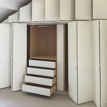 double-height-wardrobe-with-built-in-bookcase-and-concertina-doors