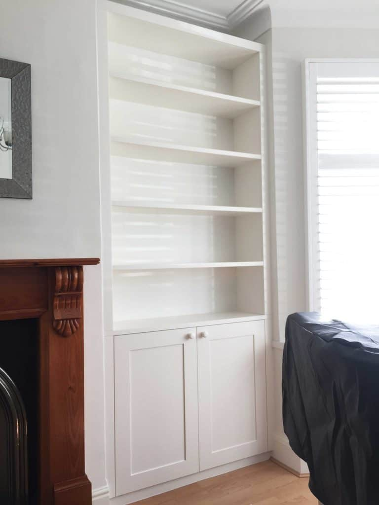 white-alcove-unit-with bottom-cupboard-and-five-shelves